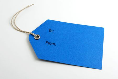 Close up of a blank gift tag on white background Stock Photo