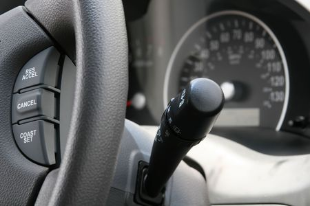 A cropped shot of a modern day car steering wheel and controls