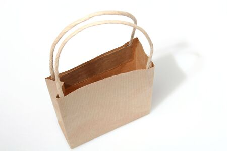 paperbag: Empty brown paperbag isolated on white, perfect to put your design on the side