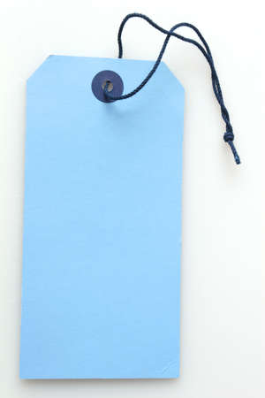 a blank blue label tag with string attached