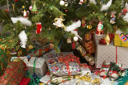 christmas presents under a decorated christmas tree