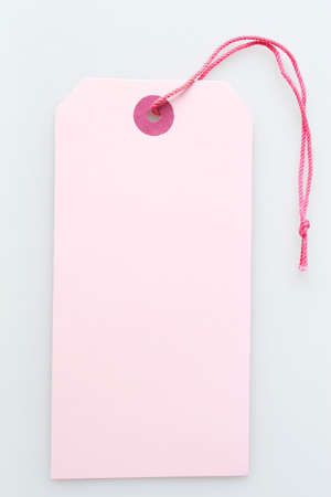 discounted: a blank pink label tag with string