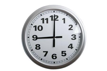 o�??clock: Un reloj de pared con estilo mostrando las 9 horas, aislados en blanco  Foto de archivo