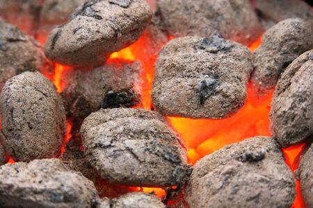 charcoal brickets burning down, close up shot