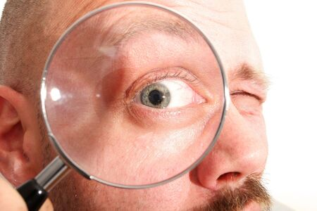A man looking through a magnifying glass, weird view Stock Photo - 3400195
