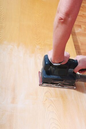 sander: finishing sander being used on wood Stock Photo