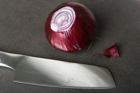 red onion: Red onion and stainless steel knife