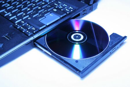 brand new laptop with cd in open cd drive, shot on white Stock Photo - 2166142