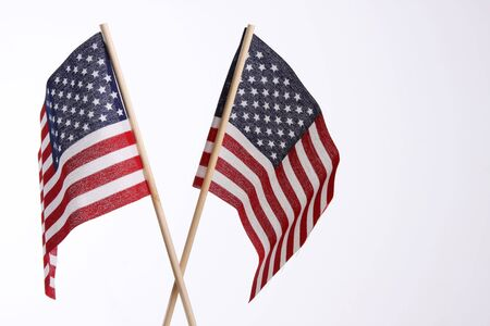 meant: two small us flags meant for use in national holidays and celebrations
