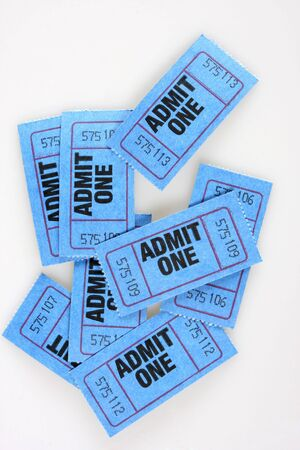 Blue admission tickets, admit one written on them