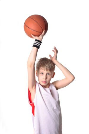 A 10 year old boy concentrating before a shooting a basketball