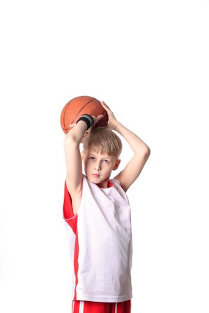 A 10 year old boy concentrating before a shooting a basketball Stock Photo - 3400185