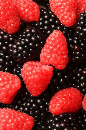 lighthing: A pile of raspberries and blackberries in a bowl, shot in studio Stock Photo
