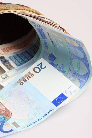 A bunch of Euros in a wallet, tens and twenties, shot in studio photo