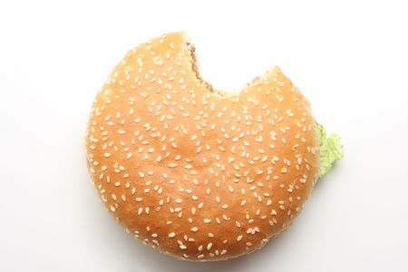 junkfood: Hamburger isolated on white, one bite taken out of it Stock Photo