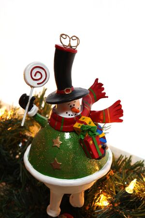 A decorative christmas snowman, white background and christmas lights photo
