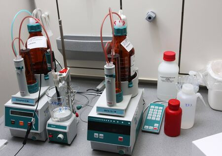 generic medicine: chemicals and equipment in a real life pharmaceuticals laboratory Stock Photo