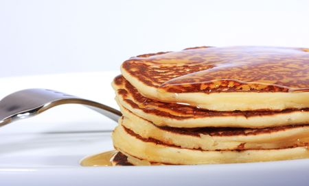 pile of american pancakes with syrup