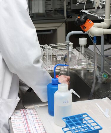 scientist working with chemicals and equipment in a real life pharmaceuticals laboratory Stock Photo - 3393411