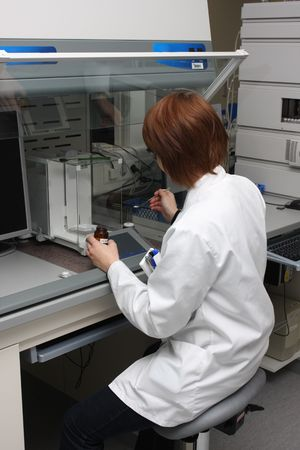scientist working with chemicals and equipment in a real life pharmaceuticals laboratory Stock Photo