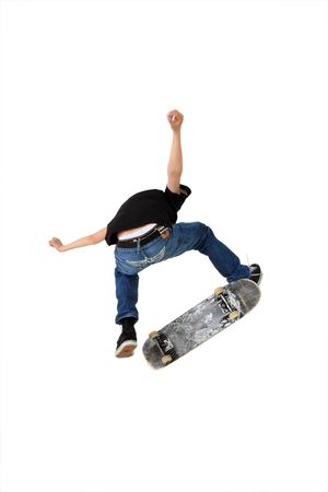 Skateboarder doing a kickflip with his board, Shot in studio and isolated on white with some motion blur