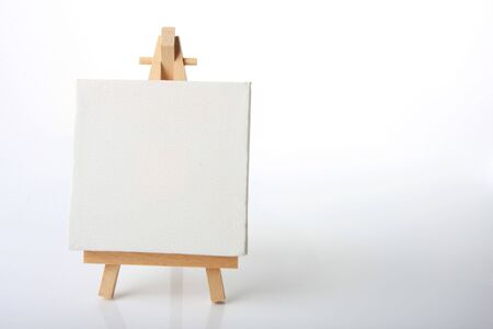 Empty artistst canvas on an easel, shot on white, put your own image on it