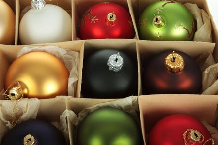 boxed: A group of christmas balls in a paper box, multiple colors Stock Photo