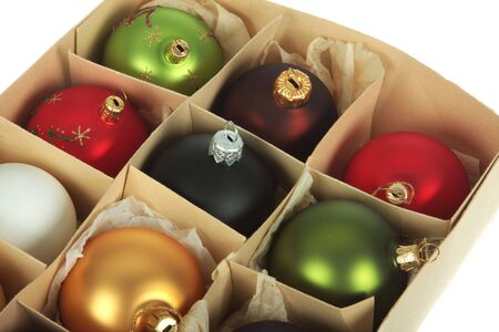 boxed: Old cardboardbox full of christmas ball ornaments, shot on white