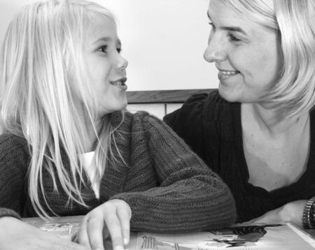 Mother helping her young daugher to do her school homework Stock Photo - 3826635