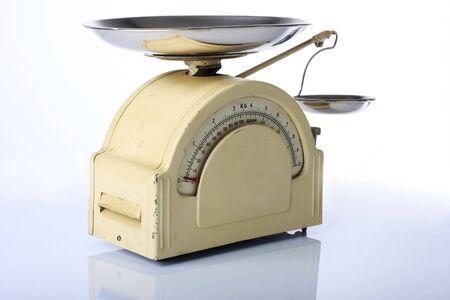 vintage kithcen scale, isolated on white photo
