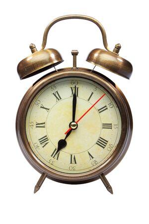 seven o'clock: An old fashioned alarm clock at seven oclock