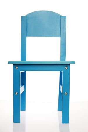 A simple blue wood chair isolated on white shot from the front