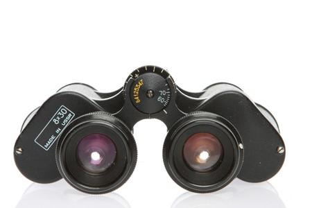 Old vintage soviet binoculars isolated on white