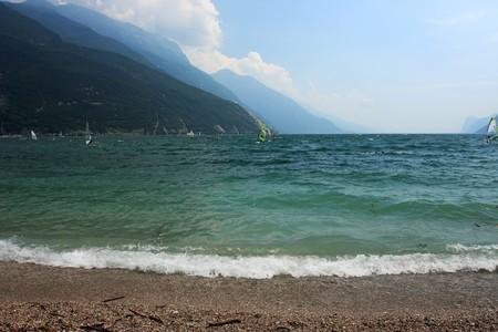 windsurfers: Windsurfers surfing on lake Garda Italy