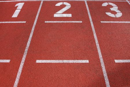 Lanes 1, 2 and 3 on a running track, great texture and detail in the ground of the track