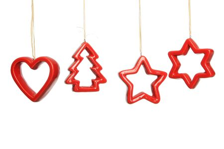 Simple red christmas decorations hanging against a white background Stock Photo - 6827401