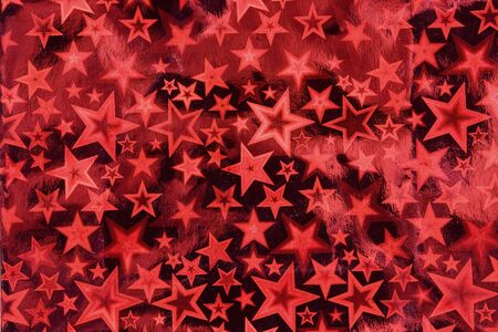 red metallic: red metallic paper background with star pattern
