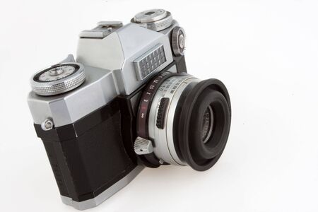 Old vintage SLR film camera isolated on white. Stock Photo - 6827528