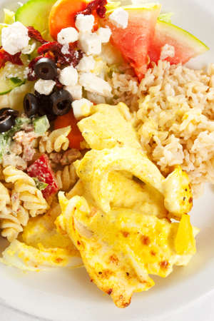 A plate of fried fish with brown rice and salad, epitomy of a healthy diet Stock Photo - 9857030