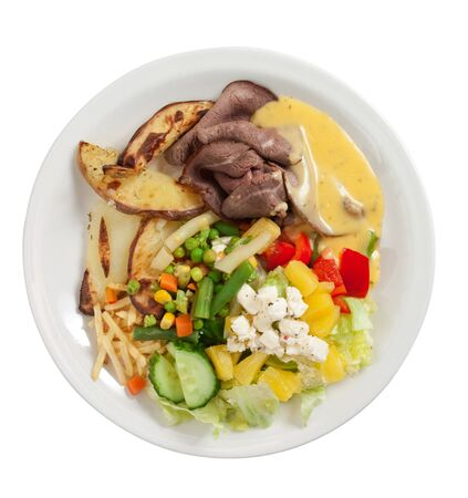 Roast beef with salad, potatoes and bernaise sauce isolated on white. Stock Photo - 9856606