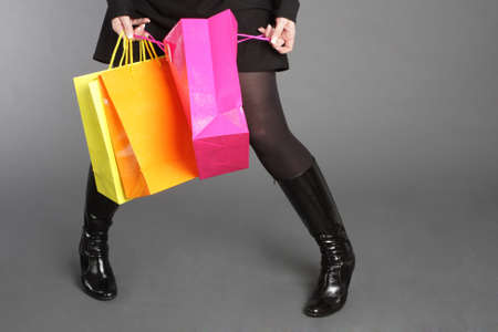 Woman holding colored shopping bags Stock Photo - 9856620