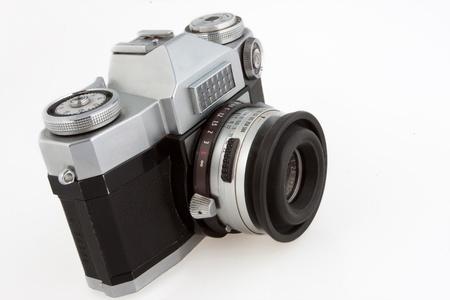 Old vintage SLR film camera isolated on white. Stock Photo - 9856878
