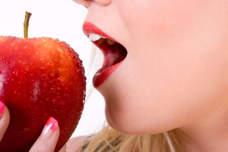 cropped shot of a young woman about to bite into a fresh red apple Stock Photo - 9856616