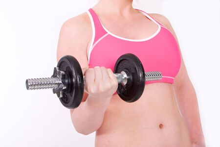 A fit young and sexy woman lifting weights. Great for health and fitness concepts Stock Photo - 9856884