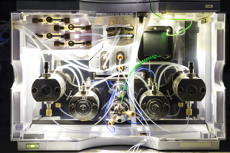 close up shot of the insides of a HPLC module in a real life laboratory Stock Photo