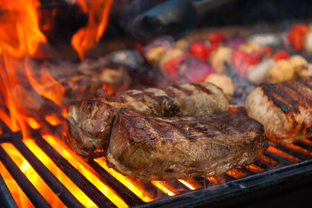 barbecue fire: Meat and vegetables char-grilled over flame