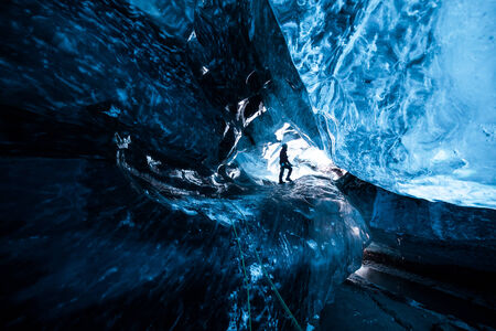 iceland: Cave explorer in an icecave in Iceland Stock Photo
