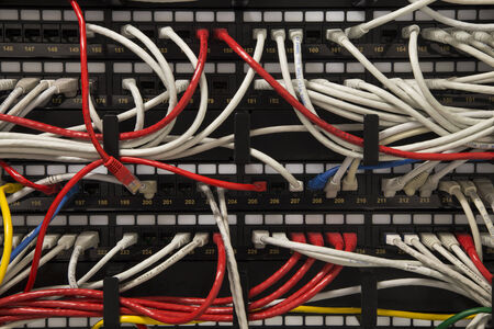 Cat5 cables in a rack mounted network switch photo