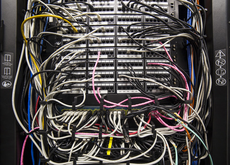 routed: Network switches with cat 5 cables in a corporate network center