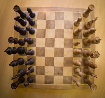 move ahead: top down view of a chess board Stock Photo
